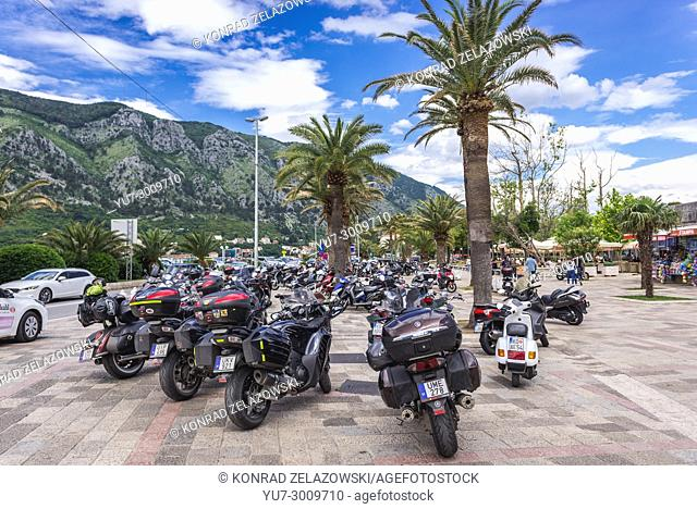 Motorbikes on a market square between marina and Old Town of Kotor coastal city, located in Bay of Kotor of Adriatic Sea, Montenegro