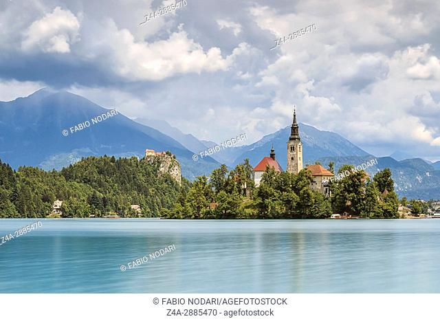 Beautiful view of Lake Bled with Island, Church And Castle With Mountain Range (Stol, Vrtaca, Begunjscica) In The Background- Bled, Slovenia, Europe