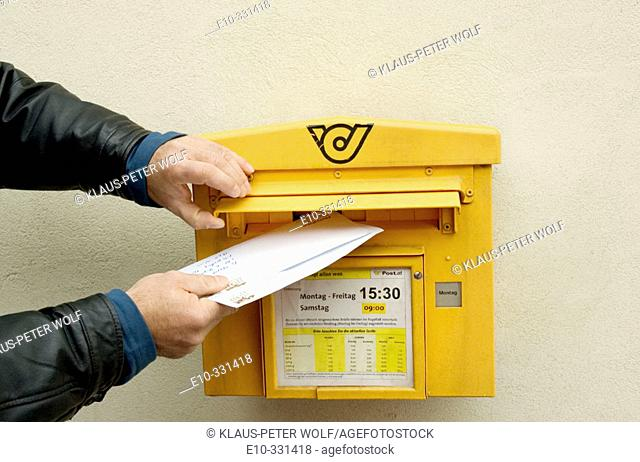 Letters are dropped in a letterbox. Austria
