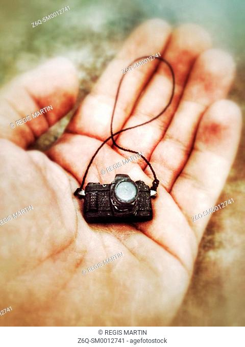 Toy camera in a man's hand