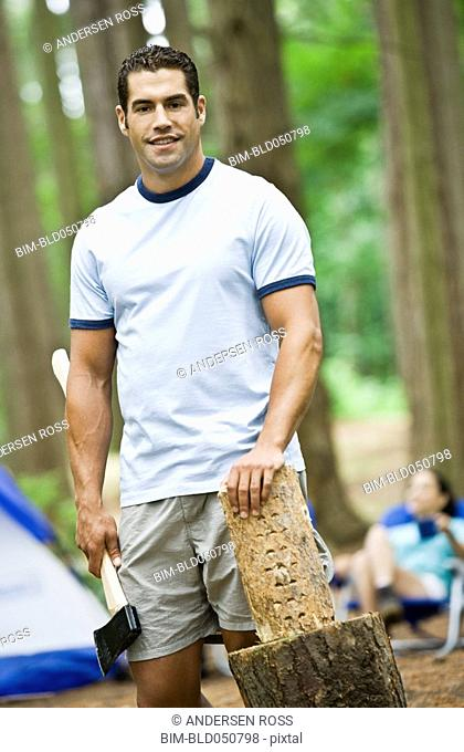 Hispanic man chopping wood