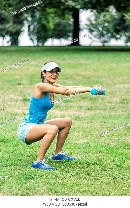 Young woman working out in park