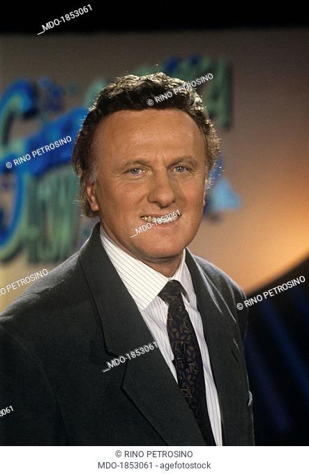 Italian TV presenter Marco Columbro Maurizio Seymandi smiling in the studio of the TV show Superclassifica Show. Italy, 1992