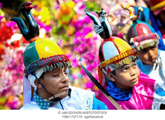 Salvadoran boys, dressed as Moors and Christians, perform the traditional dance during the Flower & Palm Festival in Panchimalco, El Salvador