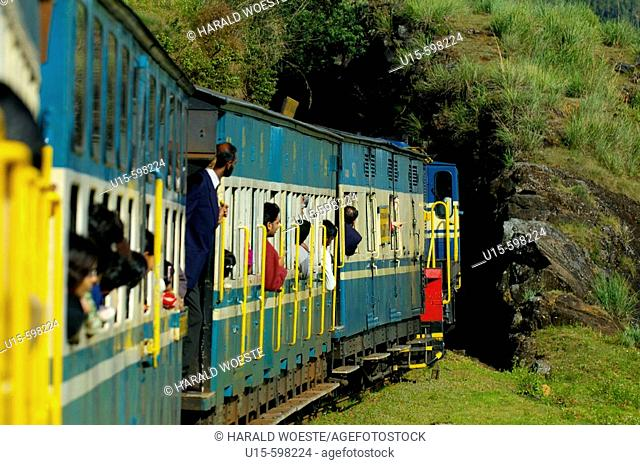 Passengers looking out of the train windows of the Nilgiri Mountain Railway before entering a tunnel during a trip from Ooty to Coonoor