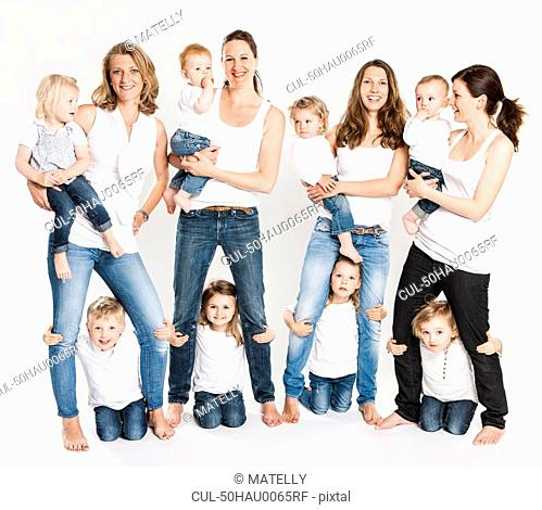 Mothers and children posing together