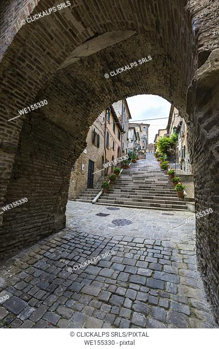 A typical alley of the old town in the medieval village of Corinaldo Province of Ancona Marche Italy Europe