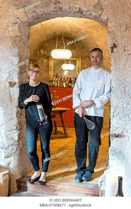 Entrance to the restaurant Taberna Romani with Armin and Sabine Pernstich, Tramin, South Tyrolean Wine Route, South Tyrol, Italy