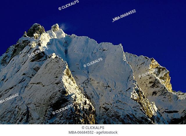 A steep rock wall in winter conditions, Cima del Largo, Valbregaglia, Graubunden, Switzerland
