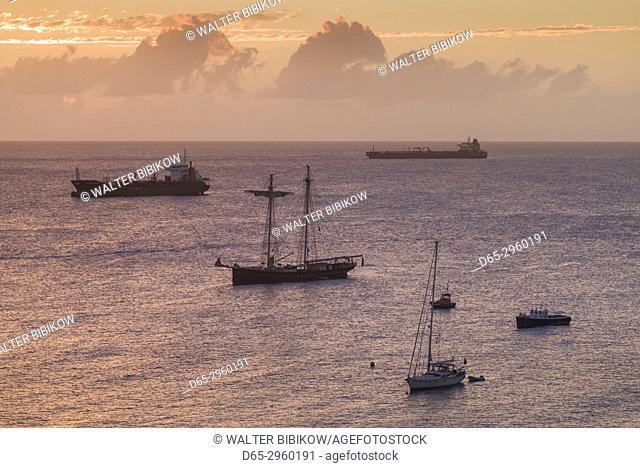 Netherlands, Sint Eustatius, Oranjestad, Oranjestad Bay, elevated view with oil tankers, dusk
