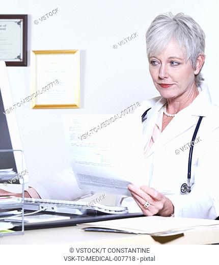 USA, California, Fairfax, Female doctor using computer at desk