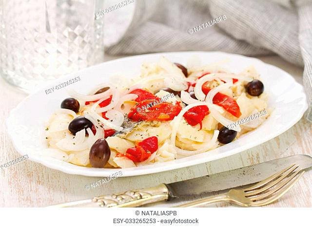 fish with red pepper and olives on dish