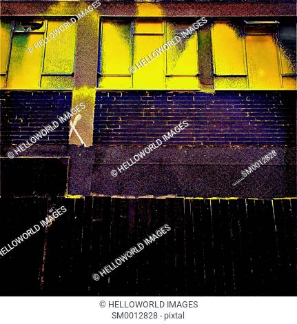 Yellow paint splashed on urban architecture, east London, England, Europe
