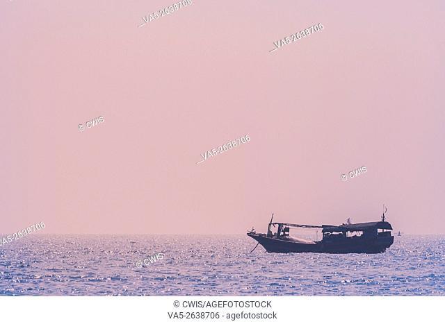 Hainan Island, China - The view of a fishing ship anchoring off the shore