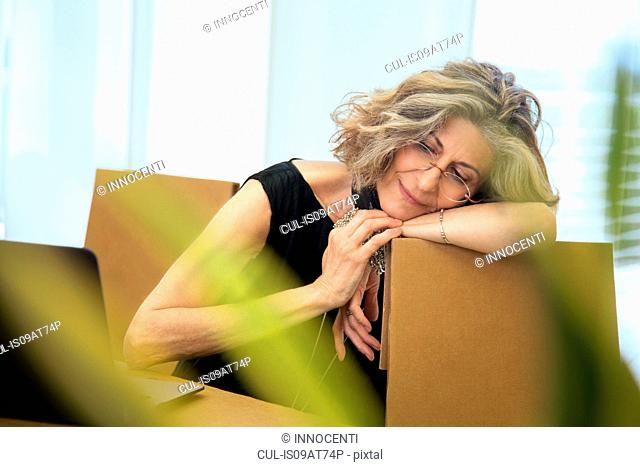 Senior businesswoman relaxing on office chair