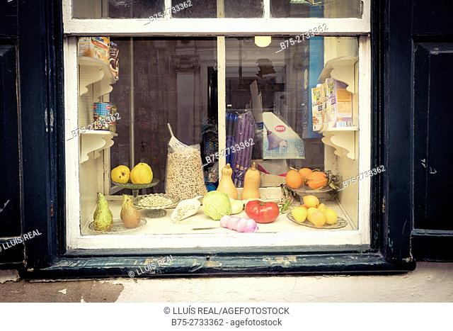 Vegetables in grocery window (tomatoe, cabbage, garlic, gourds, pears...). Mahon, Miinorca, Balearic Islands, Spain
