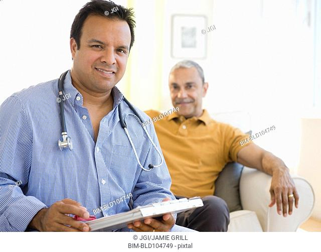 Hispanic doctor examining patient