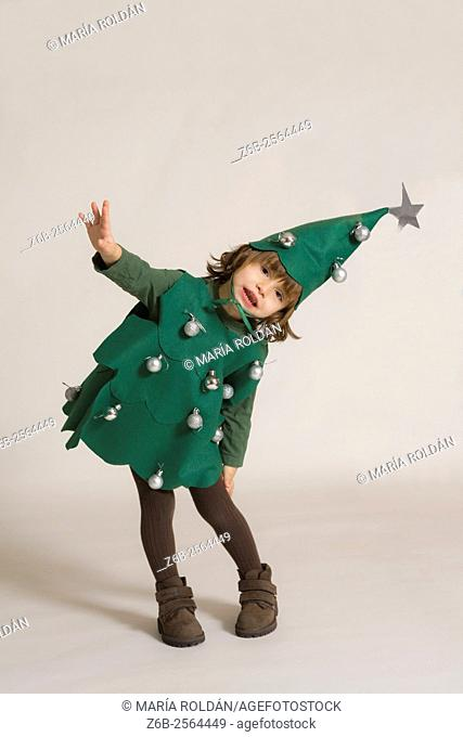 Christmas; 3 years old little girl dressed up as a Christmas tree,