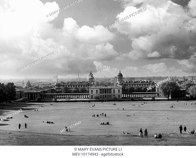 A fine view from Greenwich Park, London, with the National Maritime Museum in the foreground. The central building is the Queen's House