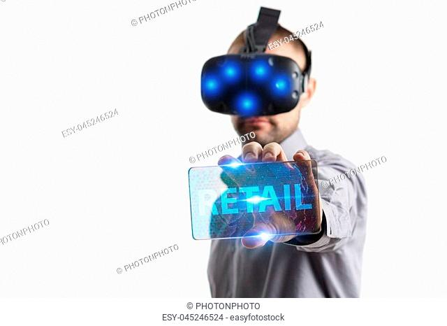 Business, Technology, Internet and network concept. Young businessman working in virtual reality glasses sees the inscription: Retail