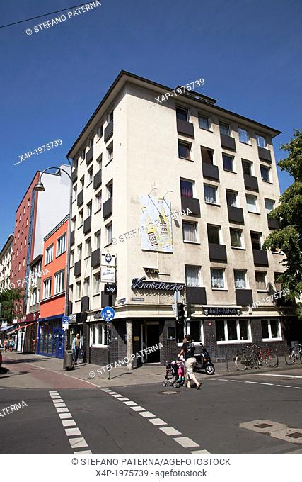 Building and facade on the street corner Aachener Street and Bruesseler Street in Cologne, Germany