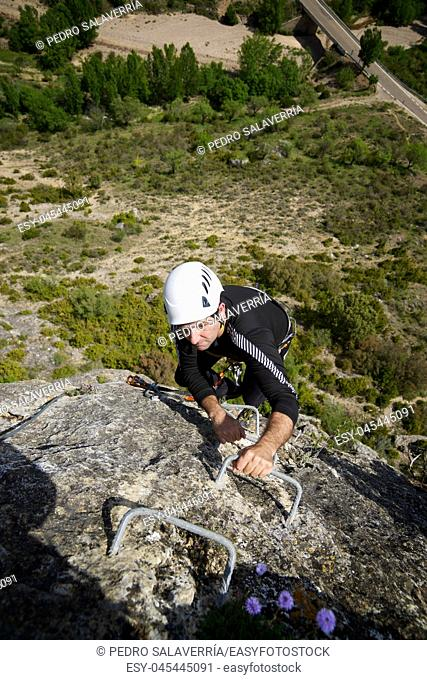 Climbing a Ferrata route in Calcena, Zaragoza Province, Aragon, Spain