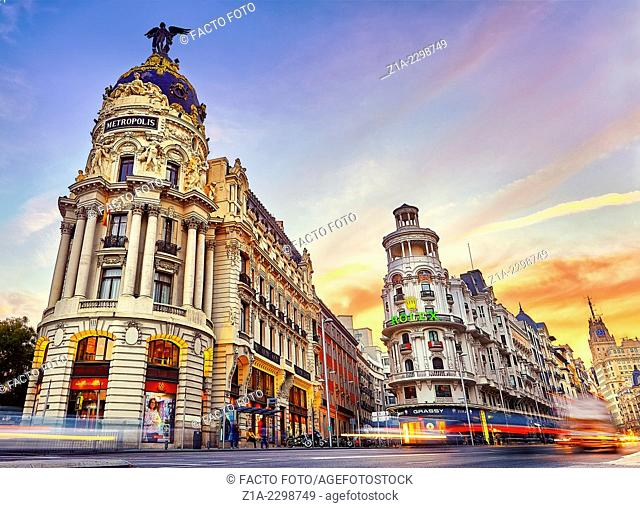 Metropolis building and Gran Via street at sunset. Madrid, Spain