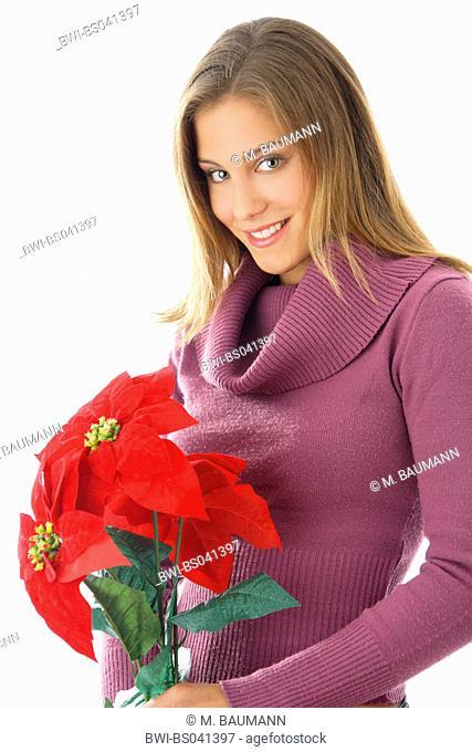 poinsettia (Euphorbia pulcherrima), Young woman with poinsettia