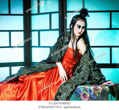 Beautiful young Japanese woman wearing red dress and kimono