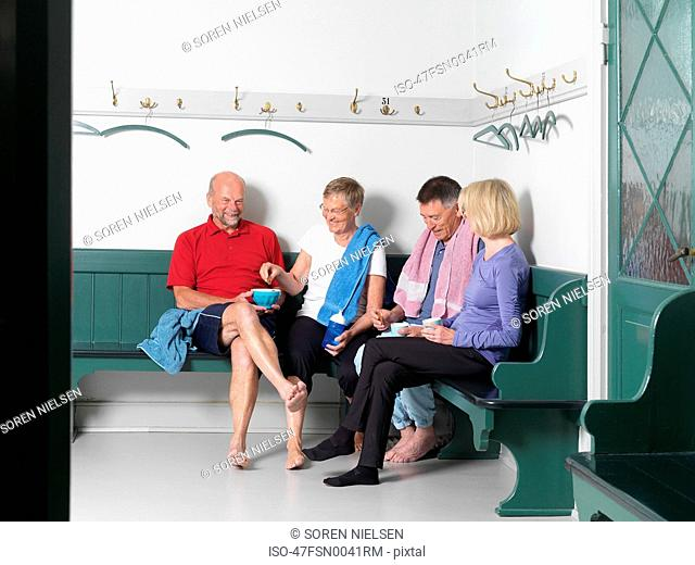 Older people sitting in locker room