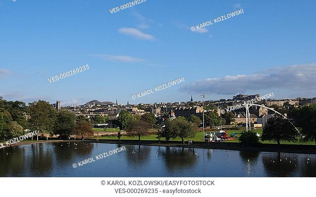 Inverleith Pond in Inverleith Park and cityscape of Edinburgh, Scotland, United Kingdom
