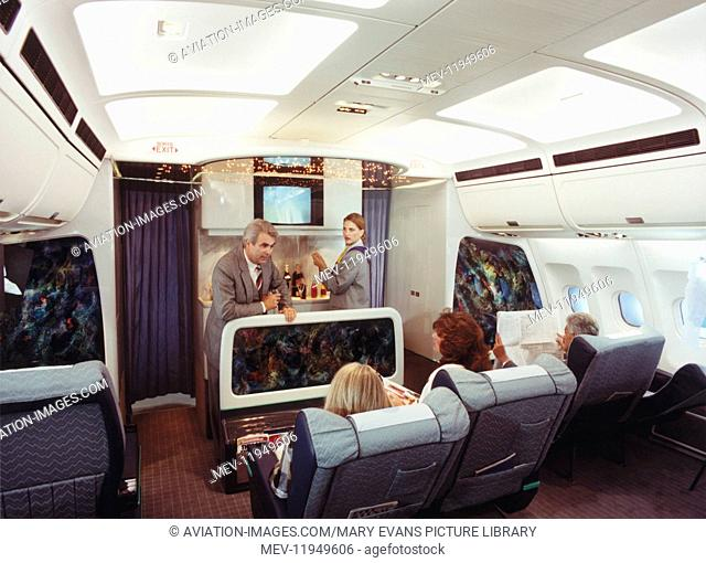 Airbus A340 First-Class Cabin with Steward and Stewardess Serving Drinks to Passenger