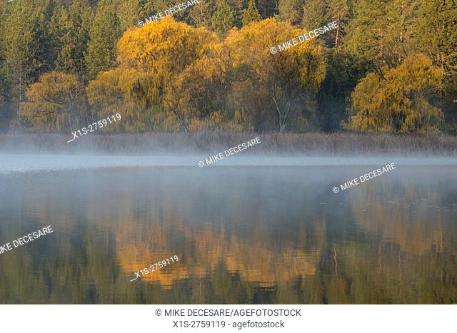 Fog lifts over a lake in Eastern Washington