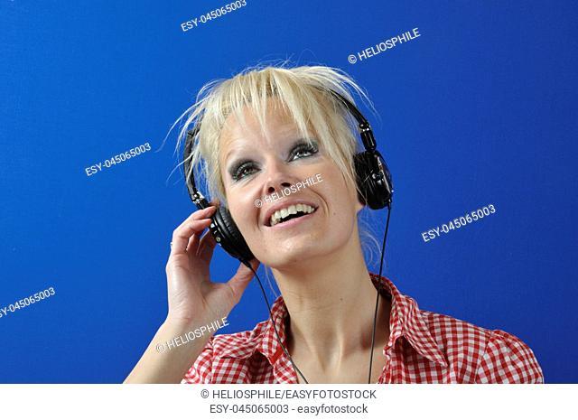 Blond woman listening to music
