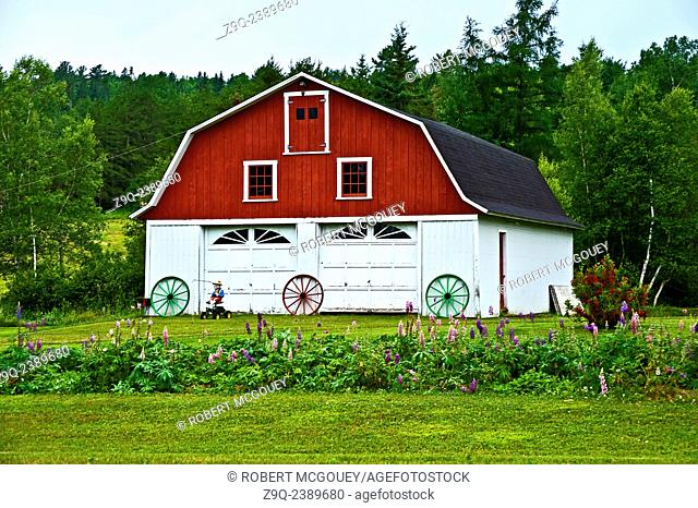 This image is of a barn that has been converted to a garage on a farm in rural New Brunswick Canada