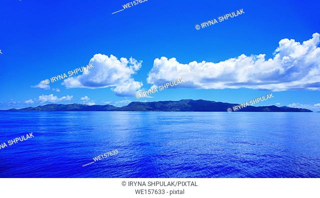 Island Praslin, Indian Ocean, Republic of Seychelles. . Island Praslin seen from sea, Indian Ocean, Republic of Seychelles