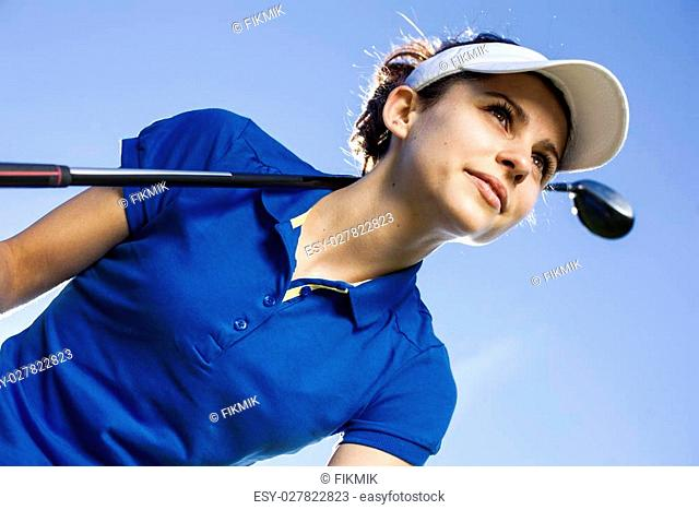 Portrait of a woman playing golf in summer