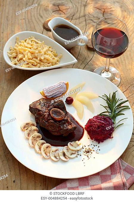 Shoulder of venison with Spätzle soft egg noodles from Swabia and roasted vegetables