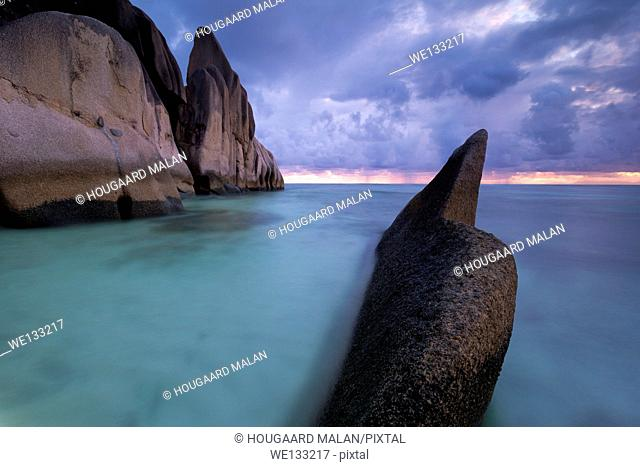 Landscape view of a stormy sunset on the famous Anse source d'Argent beach. La Digue Island, Seychelles
