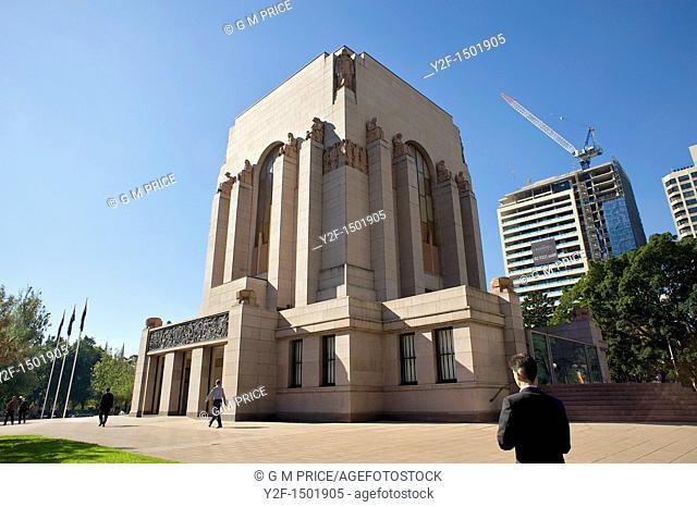 men walking past Anzac War Memorial, Hyde Park, Sydney, Australia