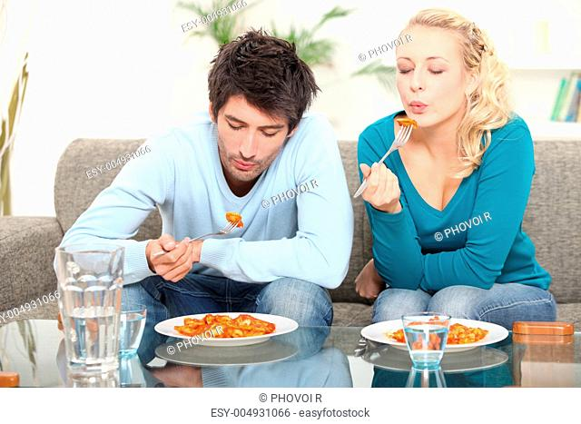 Couple eating meal at home