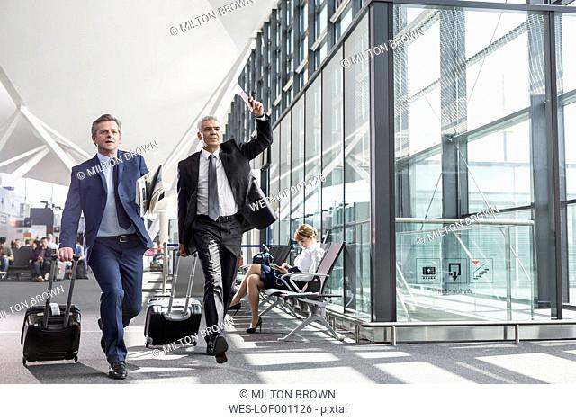 Two businessmen in a hurry at the airport