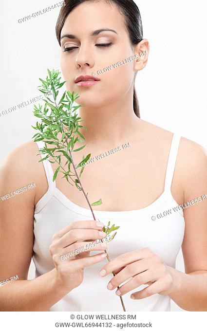 Close-up of a woman smelling aroma herbs