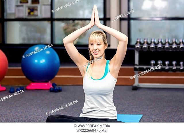 Smiling woman doing yoga exercise
