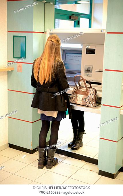 Student Withdrawing Money from BTM Machine in Bank Aix-en-Provence France
