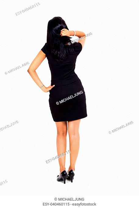 rear view of black haired businesswoman thinking