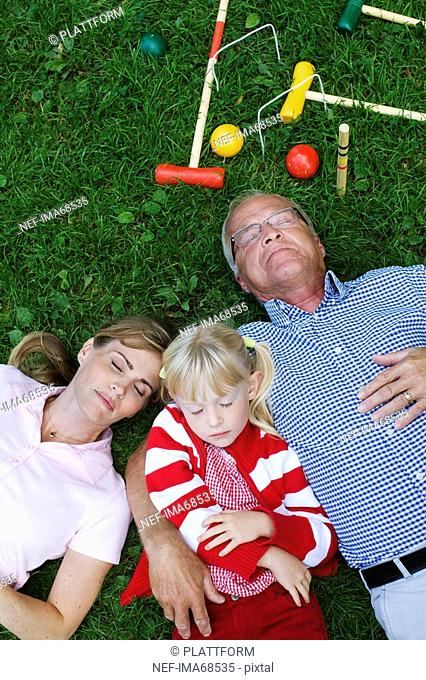 A senior man girl and woman resting in the park Sweden
