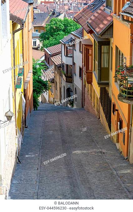 Old medieval narrow stone paved street in Buda district of Budapest on a sunny day in summer. Shot at Gul Baba street