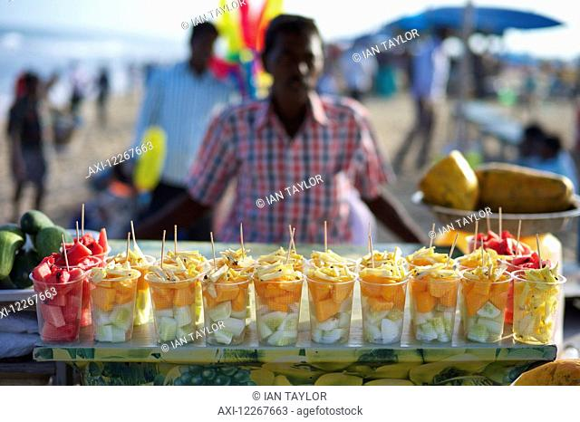 Fruit seller on Marina Beach; Chennai, Tamil Nadu, India