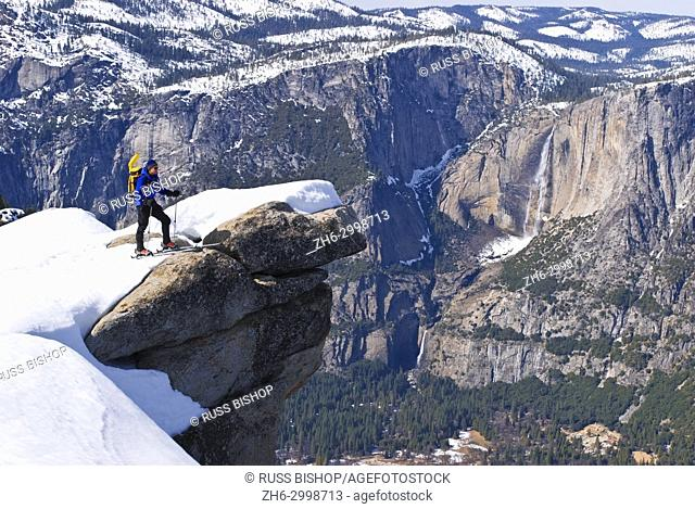 Backcountry skier and Yosemite Falls from Glacier Point, Yosemite National Park, California USA